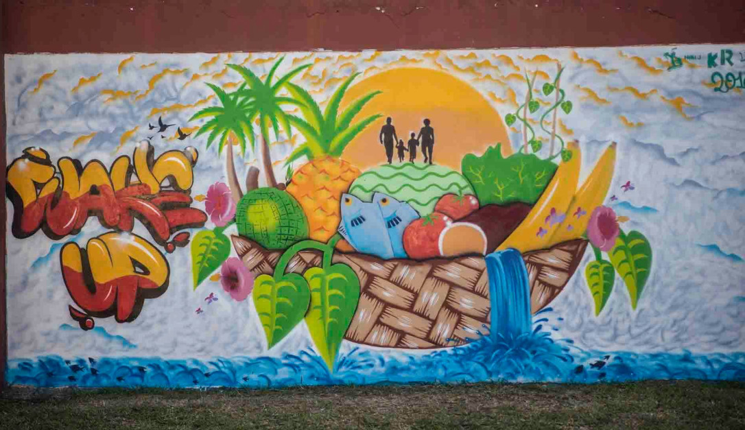 Healthy island waking up with the sun - Mural painted by youth from Vanuatu